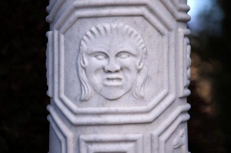 fuschias: Carved Column in Garden on the Big Sur in California USA