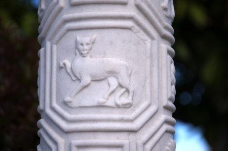 fuschias: Carved Column in Garden on the Big Sur in California