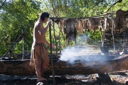 loincloth: The Plimoth Plantation Museum in Plymouth Massachusetts where actors create the settlement of the Pilgrims & Wampanoag Indians