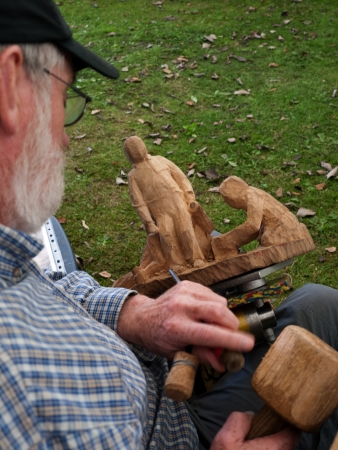Burnley,Lancashire,festival, craftsman,crafts,wood,carving,crowds, woodland,park.celebration,Brenda kean,clogs,footware,leather,chisel Stock Photo - 20062541