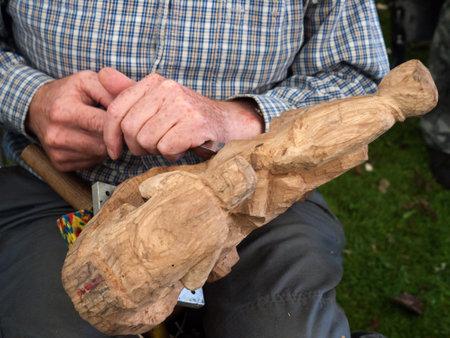 brenda kean: Burnley,Lancashire,festival, craftsman,crafts,wood,carving,crowds, woodland,park.celebration,Brenda kean,clogs,footware,leather,chisel