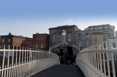 The Halfpenny Bridge over the River Liffey in Dublin Ireland