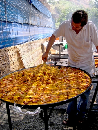 alpujarra: Cooking a gigantic paella on the beach at Nerja Andalucia Spain