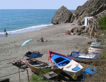 alpujarra: fishing boats on the Burriana Beach at Nerja Spain