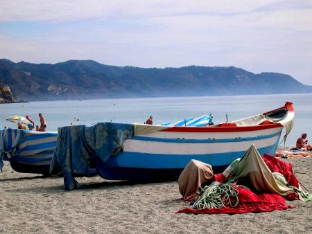 burriana beach: fishing boats on the Burriana Beach at Nerja Spain