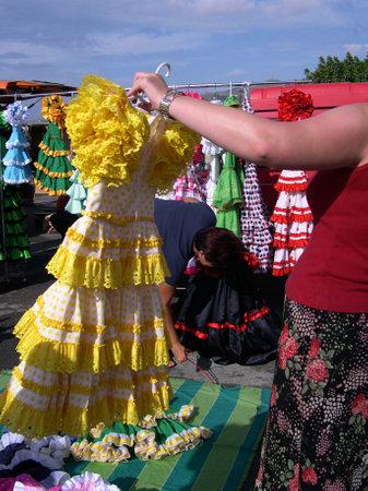 Flamenco dresses for sale on Nerja Market on the Costa Del Sol in Spain