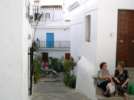 alpujarra:  Gossiping in Frigiliana in Andalucia Spain