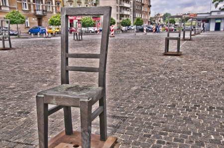 atrocity: The Square of Empty Chairs in Krakow a monument to all the victims of the Holocaust