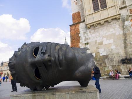 portcullis: Big Giant Head in the Main Market Square in Krakow Poland Editorial