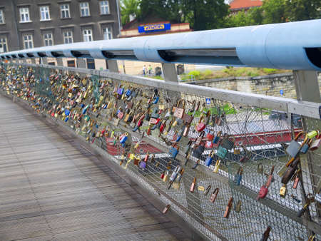 Bridge with Lovers Locks on Bridge over the River Vistula in Krakow Poland