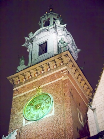 The towers of Wawel Castle at night in Krakow Poland