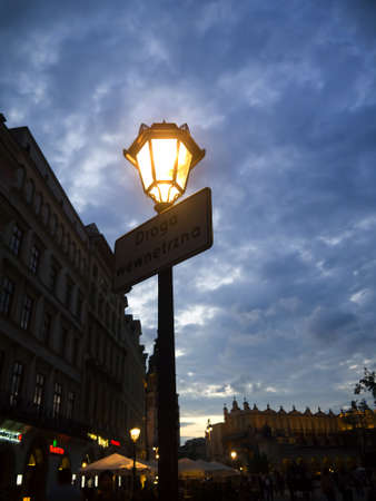 cloth halls: night falls over the Great Market Square in Krakow Poland