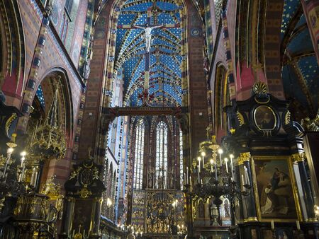 cloth halls: Church of Mariacki or St Marys Church in Krakow Poland Editorial