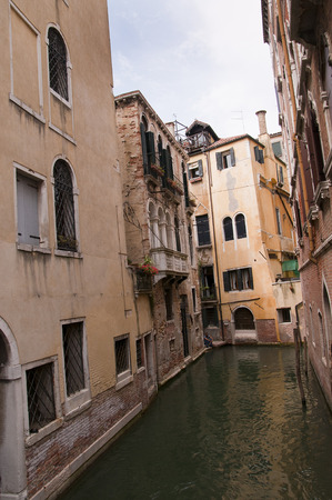 clock of the moors: Narrow canal  in Venice Italy