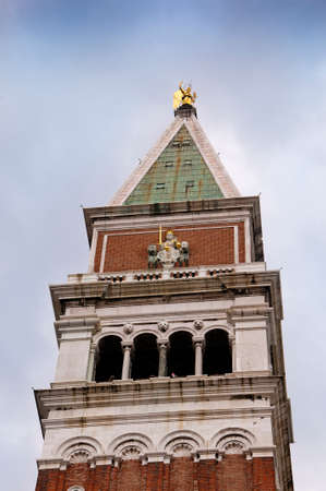 Campanile or bell Tower of St Marks Cathedral in Venice Italy photo