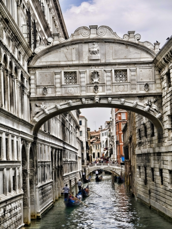 Gondola ride under the Bridge of Sighs in Venice Italy photo