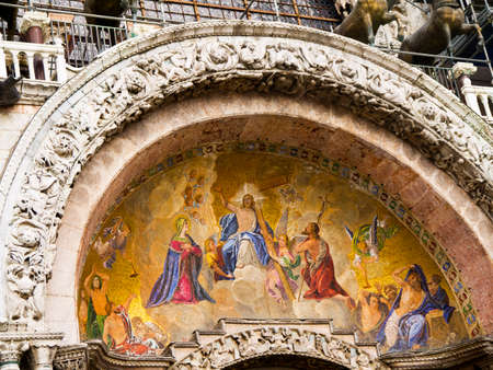 clock of the moors: The facade of St Marks Cathedral in Venice Italy Editorial