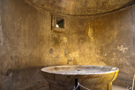 Lustral bowl of the mensbaths in Pompeii Ttaly photo