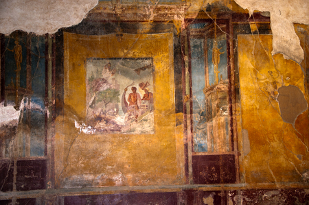 Ruined frescoes in the once buried city of Pompeii Italy