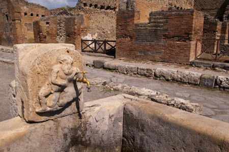 Street water fountain in the once buried city of Pompeii Italy photo