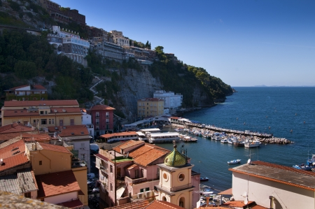The old town of Sorrento going down into the original fishing harbour of Marina Grande in Sorrento a small city in Campania, Italy   It is a popular European tourist destination photo