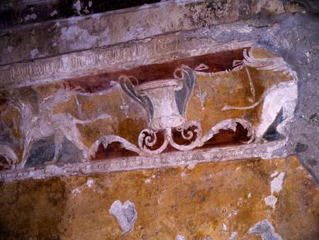 Wall detail in the Mens Public Baths in the once buried city of Pompeii Italy