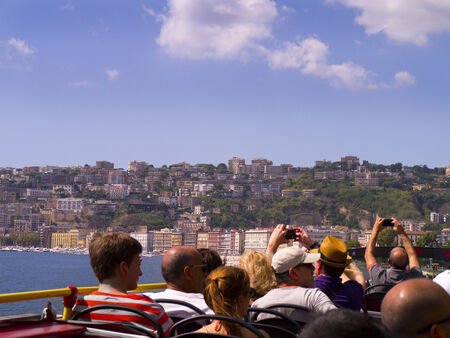 italian alpine troops: Viewing the city of Naples on a Tourist bus