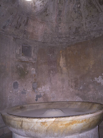 Lustral bowl of the mens baths in Pompeii Ttaly