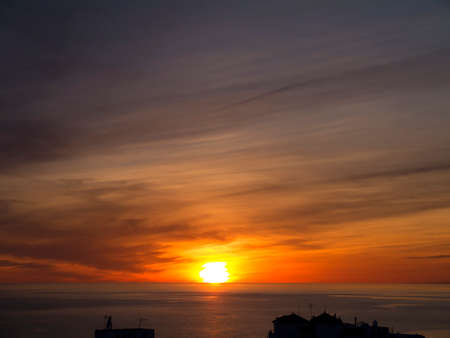 nerja: Sunset over the sea at Nerja Andalucia Spain Stock Photo