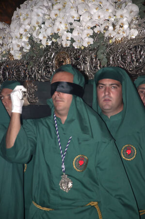 freed: Blindfolded freed prisoner in Maundy Thursday Easter Processions in Nerja Spain