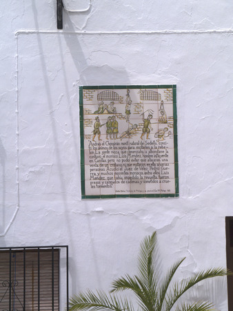 alpujarra: One of the ceramic plaques that tell the story of Frigiliana in Andalucia Spain which shows the Moorish village's last battle against the Christians in 1496