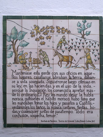 One of the ceramic plaques that tell the story of Frigiliana in Andalucia Spain which shows the Moorish village's last battle against the Christians in 1496