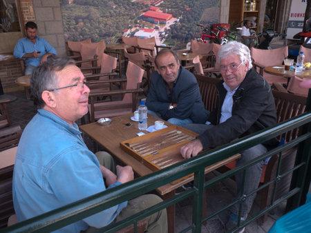 Men playing Backgammon in Kalloni Lesvos Greece Editorial
