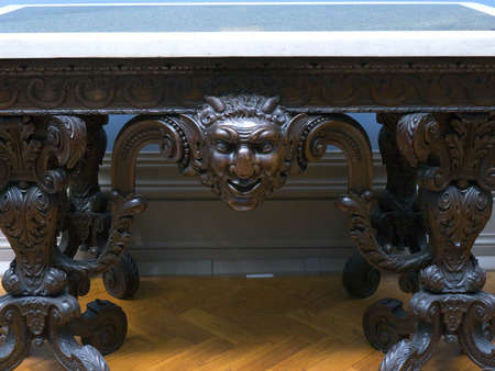 grotesque: Table with Groteseque Head in Museum
