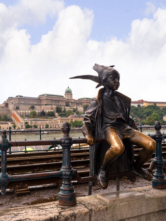 fisherman bastion: Statue of Boy Jester on the Quayside of the River Danube in Budapest