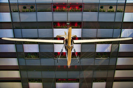 view of an atrium in a building: Vintage aeroplane in building Atrium in Budapest Hungary