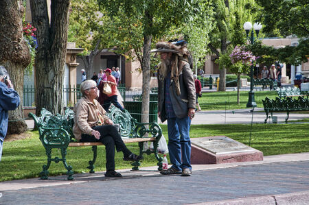 Creative Character walking the streets of Santa Fe in New Mexico USA Editorial