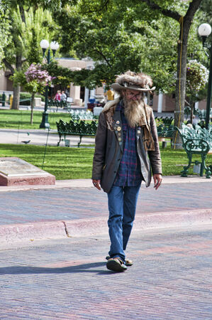 fe: Creative Character walking the streets of Santa Fe in New Mexico USA Editorial