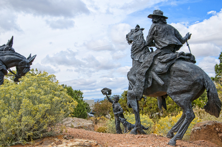 fe: Lifesize Sculpture that marks the end of the Pioneers Santa Fe Wagon Trains in the USA Editorial