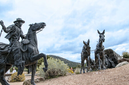 pioneers: Lifesize Sculpture that marks the end of the Pioneers Santa Fe Wagon Trains in the USA Editorial
