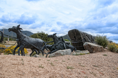 Lifesize Sculpture that marks the end of the Pioneers Santa Fe Waggon Trains in the USA