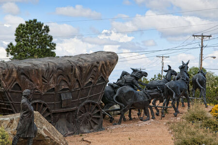 pioneers: Lifesize Sculpture that marks the end of the Pioneers Santa Fe Waggon Trains in the USA