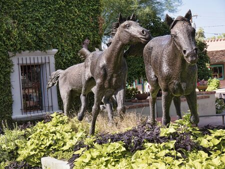 Statue of a group of Wild Horses running together in Scottsdale Arizona USA