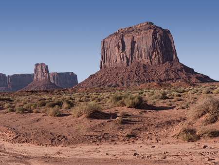 enduring: Monument Valley provides perhaps the most enduring and definitive images of the American West. The isolated red mesas and buttes are surrounded by empty, sandy desert