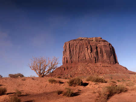 mesas: Monument Valley provides perhaps the most enduring and definitive images of the American West. The isolated red mesas and buttes are surrounded by empty, sandy desert
