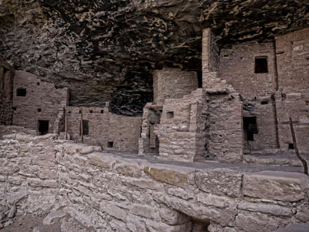 dwellings: Mesa Verde National Park Colorado USA. There are about 600 cliff dwellings with the National Park. Most cliff dwellings are set in alcoves in the cliff house sandstone. Editorial