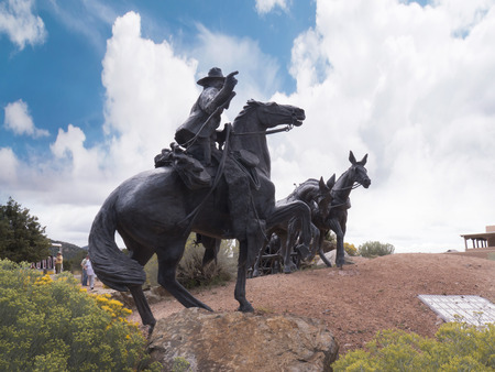 end of the trail: Huge Bronze Statue of Wagon Train Marking the end of the Santa Fe Trail  to West USA