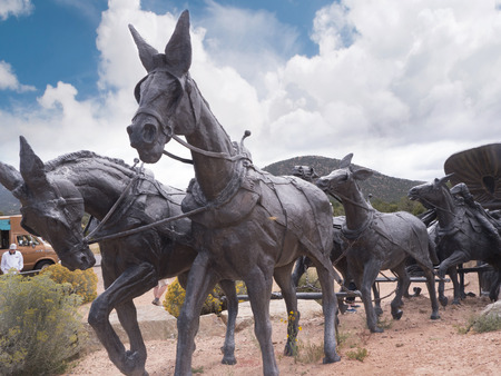 pioneers: Huge Bronze Statue of Wagon Train Marking the end of the Santa Fe Trail  to West USA