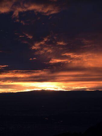 Sunset over Sandia Peak in the mountains above Albuquerque New Mexico USA Banco de Imagens