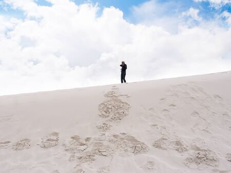 White Sands National Monument is a large unique area of fine white gypsum sand which is blown into dunes. Nearby is the Los Alamos Missile Range. photo